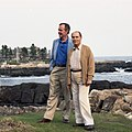 President George H. W. Bush escorts President François Mitterrand of France on a walking tour on Walker's Point in Kennebunkport.jpg