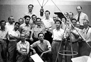 Jerusalem Calling - Photo taken at the Palestine Broadcasting Service studio in Jerusalem, July 1947, after the performance of Piano Concerto (Schumann). Menahem Pressler stands to the right of microphone.