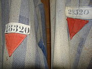 Prisoners' Uniforms with Red Triangles of Political Prisoners - Museum Exhibit - Dachau Concentration Camp Site - Dachau - Bavaria - Germany