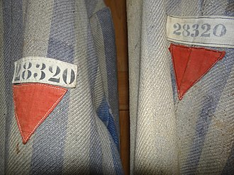 Nazi concentration camp badge - Image: Prisoners' Uniforms with Red Triangles of Political Prisoners Museum Exhibit Dachau Concentration Camp Site Dachau Bavaria Germany