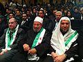 Qaradawi wih free Syria flag.jpg
