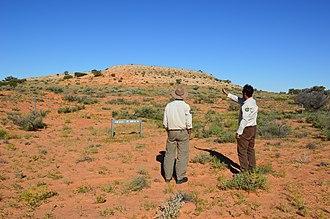 Munga-Thirri—Simpson Desert Conservation Park - Rangers looking at Approdinna Attora Knolls in the Munga-Thirri—Simpson Desert Conservation Park