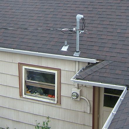 A 240/120 V split-phase service drop providing power to a residence in USA. The three wires from the utility pole enter through a weatherhead (top) into a vertical conduit, which routes them to the electric meter (bottom). From there they pass through the wall of the house to the electric panel inside. Residence service drop.JPG