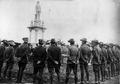 Returned soldiers in uniform surrounding the Digger War Memorial in Chinchilla ca. 1920.tiff