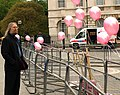 Reverend contemplates pro-choice balloons (2509077785).jpg