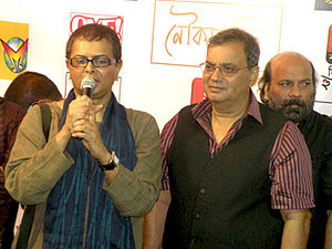 Rituparno Ghosh - Rituparno Ghosh (left) with Subhash Ghai (right) and Debojyoti Mishra (behind) at the audio release of Noukadubi
