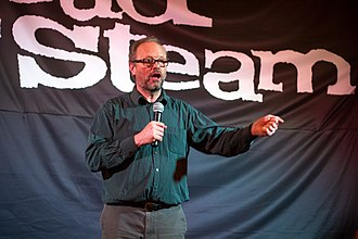 """Robert Llewellyn - Robert Llewellyn talks to the Merseyside Skeptics Society """"Electric cars are rubbish. Aren't they?"""" event at the Head of Steam pub in Liverpool."""