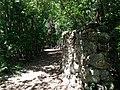 Rock wall next to path - panoramio.jpg