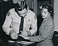 Rosa Parks being fingerprinted by Deputy Sheriff D.H. Lackey after being arrested on February 22, 1956, during the Montgomery bus boycott.jpg