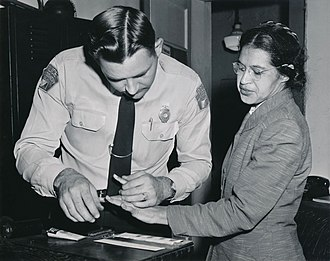 Rosa Parks being fingerprinted after being arrested for not giving up her seat on a bus to a white person. Rosa Parks being fingerprinted by Deputy Sheriff D.H. Lackey after being arrested for refusing to give up her seat for a white passenger on a segregated municipal bus in Montgomery, Alabama.jpg