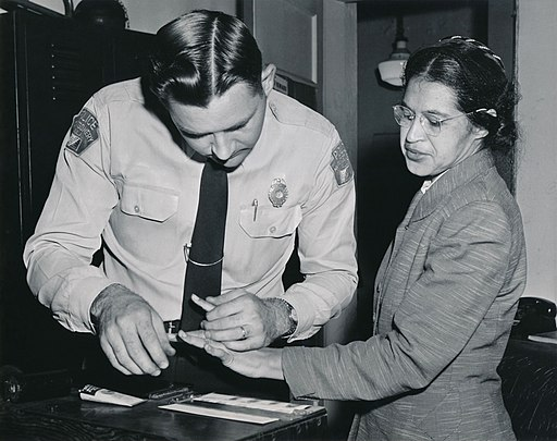 Rosa Parks being fingerprinted by Deputy Sheriff D.H. Lackey after being arrested on February 22, 1956, during the Montgomery bus boycott