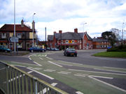 Cycle lanes on St John's roundabout in Newbury, Berkshire, England. This example is from a country where traffic keeps to the left, and traffic in the circular roadway of the roundabout travels clockwise.