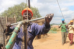 Self-supply of water and sanitation - Manual drilling of a well in Tanzania