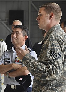 SSG Skyler DeBoer of the 58th aircraft maintenance unit briefs General Shigeru Iwasak, Japan Air Self-Defense Force Chief of Staff on F-35 Lightning II maintenance and training.jpg