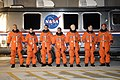STS-128 crew members alongside the Astrovan.jpg