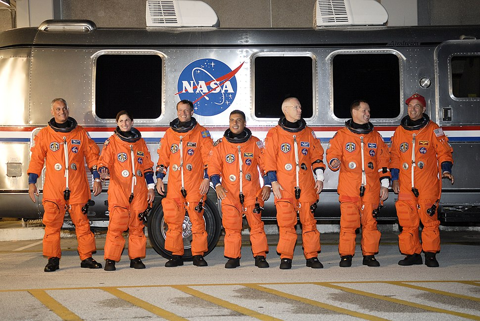 STS-128 crew members alongside the Astrovan