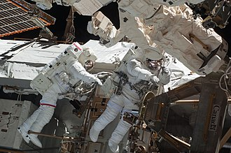 STS-130 - Astronauts Behnken and Patrick participate in the first spacewalk.