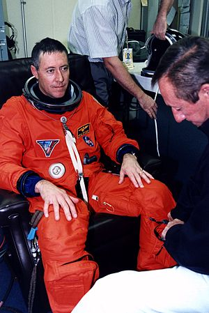 Michael A. Baker - Baker suiting up prior to launch of STS-81.