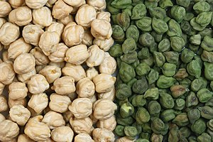 Chickpea - Two varieties of chickpea: the larger light tan Kabuli and variously coloured Desi chickpea. They are green when picked early and vary through tan or beige, speckled, dark brown to black. 75% of world production is of the smaller desi type. The larger garbanzo bean or hoummus was introduced into India in the 18th century.