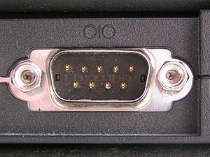 Serial port - A male D-subminiature connector used for a serial port on an IBM PC compatible computer along with the serial port symbol.