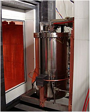 XENON - The cryostat and shield of XENON100. The shield consists of an outer layer of 20 cm of water, a 20 cm layer of lead, a 20 cm layer of polyethylene, and on the interior a 5 cm copper layer
