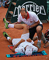 Simone Bolelli receiving treatment from the trainer (8332983271).jpg