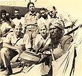 Snake charmer with hooded cobra in Calcutta in 1945.jpg