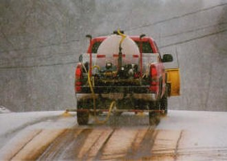 Magnesium chloride - Picture of truck applying liquid de-icer (magnesium chloride) to city streets.