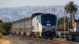 Capitol Corridor - A Capitol Corridor train with CCJPA-maintained California Cars and Amtrak-maintained P42 diesel locomotive passing through Alviso in 2016
