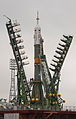 Soyuz TMA-21 spacecraft is lifted into position on the launch pad.jpg