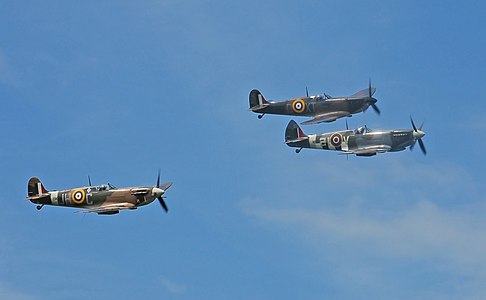 Formation flypast of three Supermarine Spitfires during the Yorkshire Air Show.