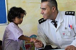 Saint John Eye Hospital Group - St John nurse with Gazan glaucoma patient.