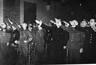 Quisling regime - The establishment of Quisling's national government was proclaimed at Akershus Fortress. On the left side of the hall are German officers, on the right Quisling (third from right) and several of his ministers