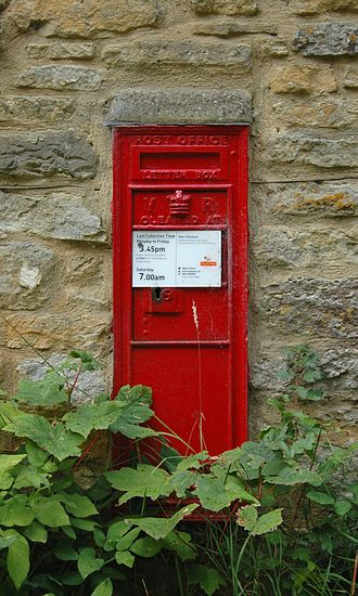 Steeple Barton - Victorian era Post Office wall box outside a cottage in Back Lane