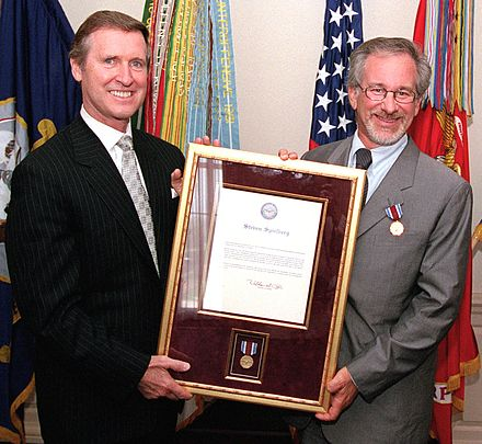 Spielberg receiving a public service award presented by United States Secretary of Defense William Cohen, 1999 Steven Spielberg 1999 4 crop.jpg