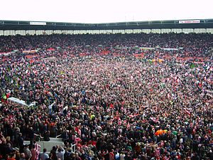 Pitch invasion - Stoke City F.C. fans invade the pitch at the Britannia Stadium to celebrate promotion to the Premier League in 2008.