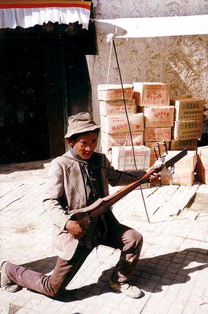 Music of Tibet - Street musician, Shigatse, Tibet, 1993
