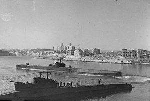 British 10th Submarine Flotilla (Malta) - HMS Rorqual and Thunderbolt mooring up at Malta's submarine base in 1943.
