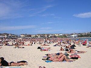 Sunbathing on a beach in Australia