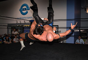 Evil (wrestler) - Watanabe (left) executing a belly-to-back suplex on Christopher Daniels