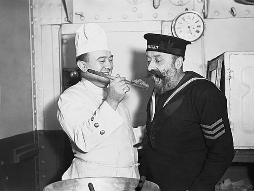 Tasting the Christmas pudding aboard HMS COCHRANE, November 1940. A1988