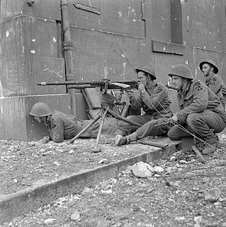 Hotchkiss machine gun - Troops of 1 King's Own Scottish Borderers (KOSB), 9th Brigade, 3rd Infantry Division, firing a captured Hotchkiss machine gun during street fighting in Caen, 10 July 1944.