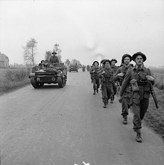 227th Infantry Brigade (United Kingdom) - Universal Carriers and infantry of the 2nd Battalion, Argyll and Sutherland Highlanders move up for the attack on Tilburg, Netherlands, 27 October 1944.