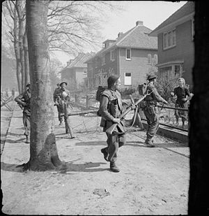 147th Infantry Brigade (United Kingdom) - Infantrymen of the 11th Battalion, Royal Scots Fusiliers, 49th (West Riding) Division, searching houses in Ede in the Netherlands, 17 April 1945.