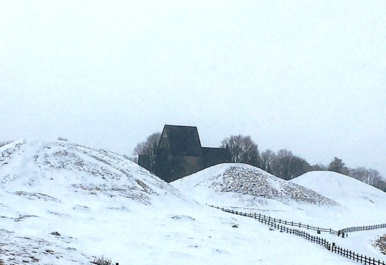 The three large royal mounds and the medieval church at Gamla Uppsala, Sweden..jpg