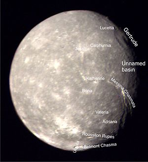 Titania (moon) - Titania with surface features labeled. The south pole is situated close to the unidentified bright crater below and left of the crater Jessica.