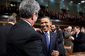 English: U.S. President greets Senator on the ...