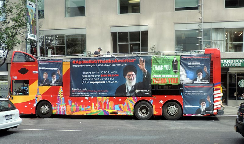 Tour bus on W58 with JCPOA ad jeh.JPG