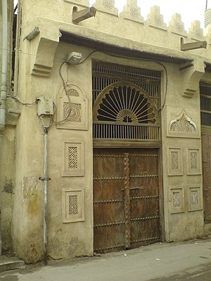 Muharraq - A doorway in the traditional architectural style in Muharraq