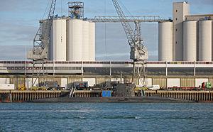 Aggreko - Aggreko trucks shoreside and Aggreko genset aboard nuclear submarine HMS Trafalgar at the NATO nuclear Z Berth in Southampton Docks, 2009.